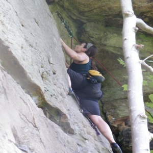 Climbing in the Prana Mika top